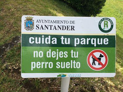 Santander con Perro Península de la Magadalena cartel cuida tu parque